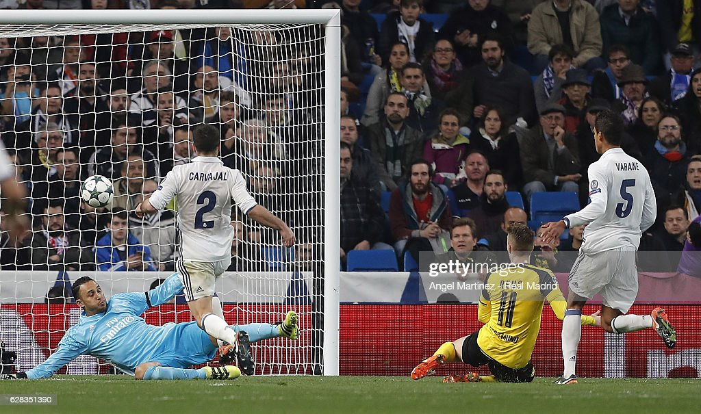 Marco Reus of Borussia Dortmund scores the equalising goal past Keylor Navas of Real Madrid during the UEFA Champions League Group F match between Real Madrid CF and Borussia Dortmund at Estadio Santiago Bernabeu on December 7, 2016 in Madrid, Spain.