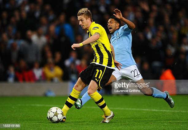 Marco Reus of Borussia Dortmund scores the first goal during the UEFA Champions League Group D match between Manchester City and Borussia Dortmund at...