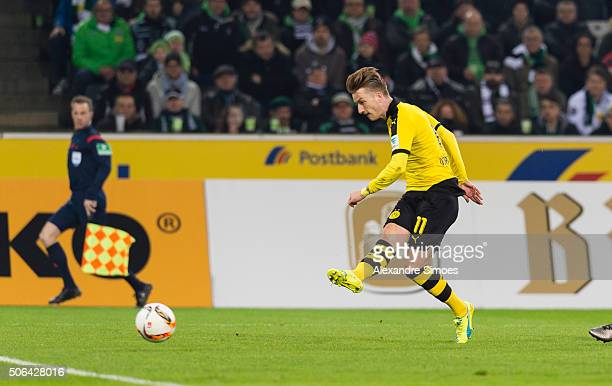 Marco Reus of Borussia Dortmund scores the opening goal during the Bundesliga match between Borussia Moenchengladbach and Borussia Dortmund at...