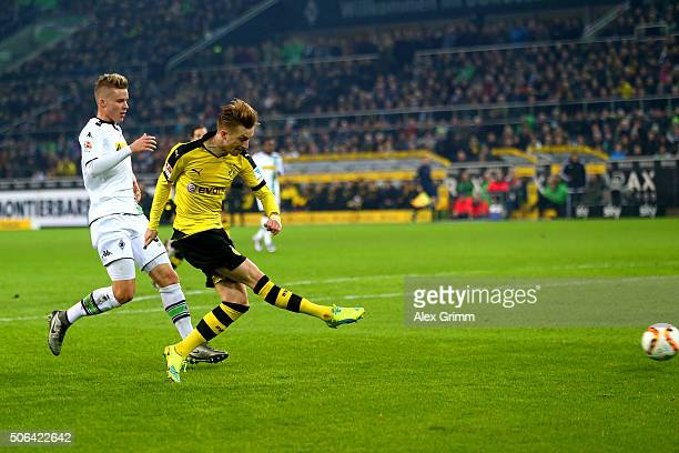 Marco Reus of Borussia Dortmund scores their first goal during the Bundesliga match between Borussia Moenchengladbach and Borussia Dortmund at...