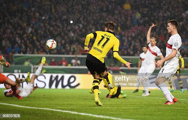 Marco Reus of Borussia Dortmund scores their first goal during the DFB Cup Quarter Final match between VfB Stuttgart and Borussia Dortmund at...