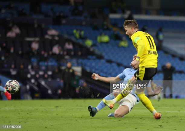 Marco Reus of Borussia Dortmund scores their team's first goal during the UEFA Champions League Quarter Final match between Manchester City and...
