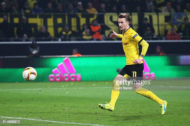 Marco Reus of Borussia Dortmund scores their third goal during the UEFA Europa League Round of 16 first leg match between Borussia Dortmund and...