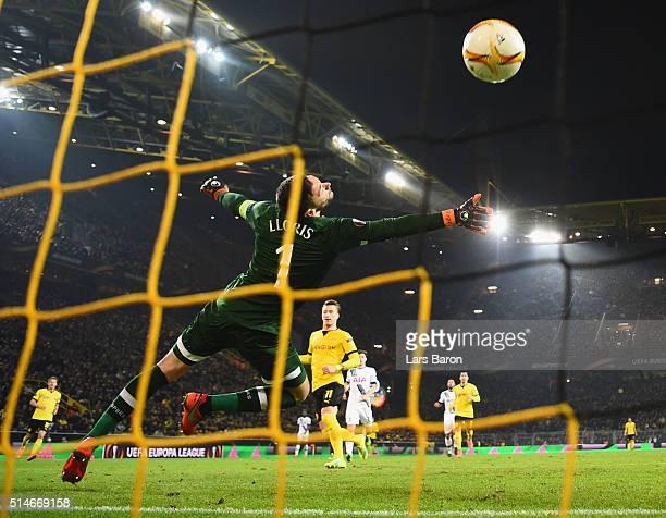 Marco Reus of Borussia Dortmund scores their third goal past goalkeeper Hugo Lloris of Tottenham Hotspur during the UEFA Europa League Round of 16...