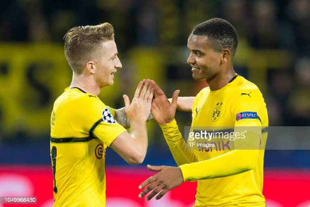 Marco Reus of Borussia Dortmund shakes hands with Manuel Akanji of Borussia Dortmund during the Group A match of the UEFA Champions League between...
