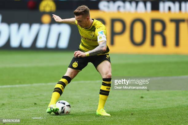 Marco Reus of Borussia Dortmund shoots and scores a goal during the Bundesliga match between Borussia Dortmund and Werder Bremen at Signal Iduna Park...