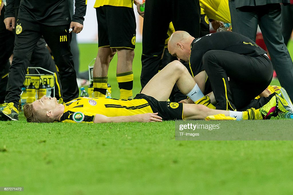 Marco Reus of Borussia Dortmund sits injured on the pitch during the DFB Cup Final match 2016 between Bayern Muenchen and Borussia Dortmund at Olympiastadion on May 21, 2016 in Berlin, Germany.
