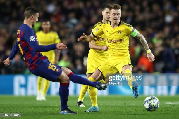 Marco Reus of Dortmund and Clement Lenglet of Barcelona battle for possession during the UEFA Champions League group F match between FC Barcelona and...