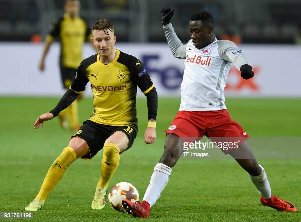 Marco Reus of Dortmund and Diadie Samassekou of Salzburg battle for the ball during UEFA Europa League Round of 16 match between Borussia Dortmund...