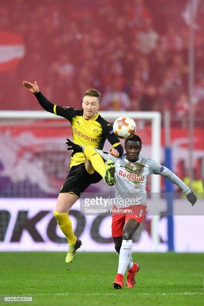 Marco Reus of Dortmund and Diadie Samassekou of Salzburg compete for the ball during the UEFA Europa League Round of 16 2nd leg match between FC Red...