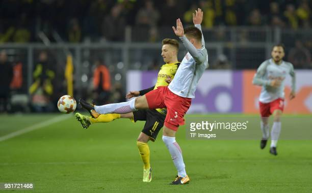 Marco Reus of Dortmund and Duje CaletaCar of Salzburg battle for the ball during UEFA Europa League Round of 16 match between Borussia Dortmund and...