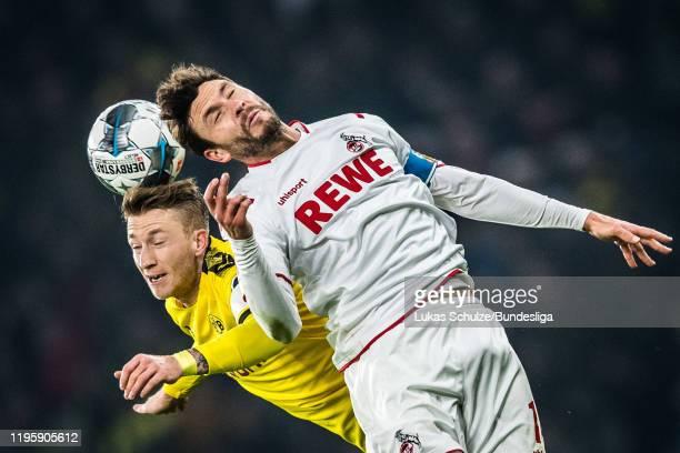 Marco Reus of Dortmund and Jonas Hector of Köln in action during the Bundesliga match between Borussia Dortmund and 1. FC Köln at Signal Iduna Park...