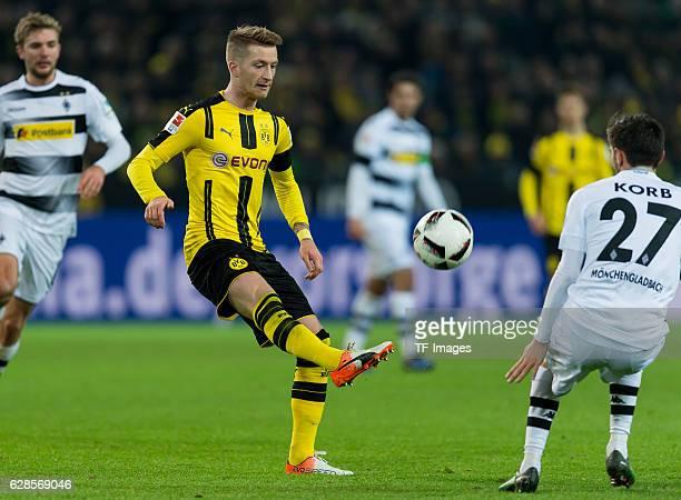Marco Reus of Dortmund and Julian Korb of Moenchengladbach battle for the ball during the Bundesliga match between Borussia Dortmund and Borussia...