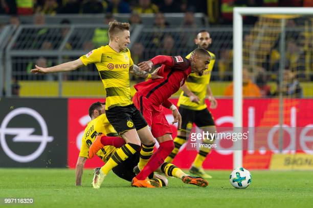 Marco Reus of Dortmund and KevinPrince Boateng of Frankfurt battle for the ball during the Bundesliga match between Borussia Dortmund and Eintracht...