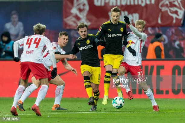 Marco Reus of Dortmund and Konrad Laimer of Leipzig battle for the ball during the Bundesliga match between RB Leipzig and Borussia Dortmund at Red...