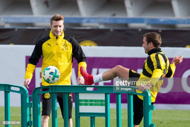Marco Reus of Dortmund and Mario Goetze of Dortmund control the ball during the Borussia Dortmund training camp at Marbella Football Center on...