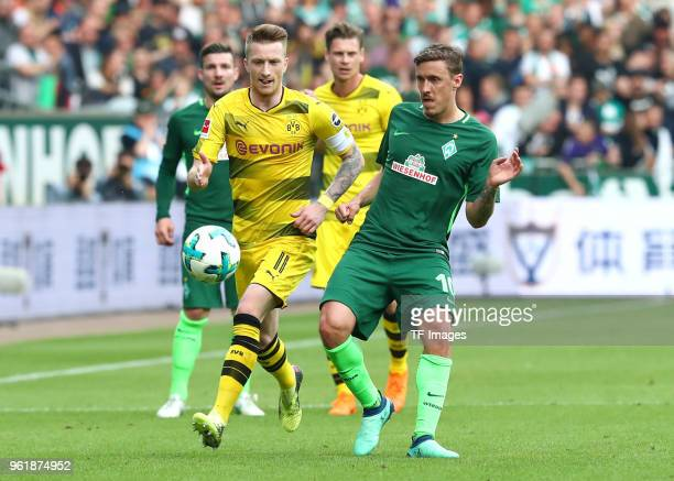 Marco Reus of Dortmund and Max Kruse of Bremen battle for the ball during the Bundesliga match between SV Werder Bremen and Borussia Dortmund at...