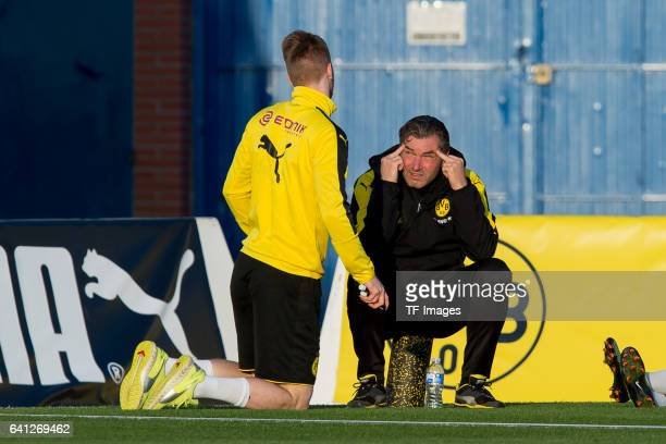 Marco Reus of Dortmund and Sports director Michael Zorc of Dortmund looks on during the fifth day of the training camp in Marbella on January 09,...