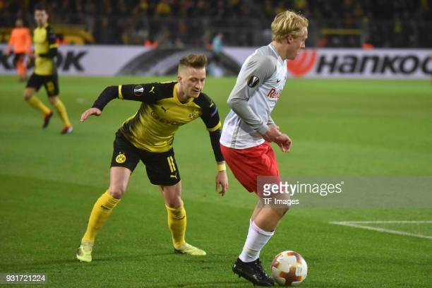 Marco Reus of Dortmund and Xaver Schlager of Salzburg battle for the ball during UEFA Europa League Round of 16 match between Borussia Dortmund and...