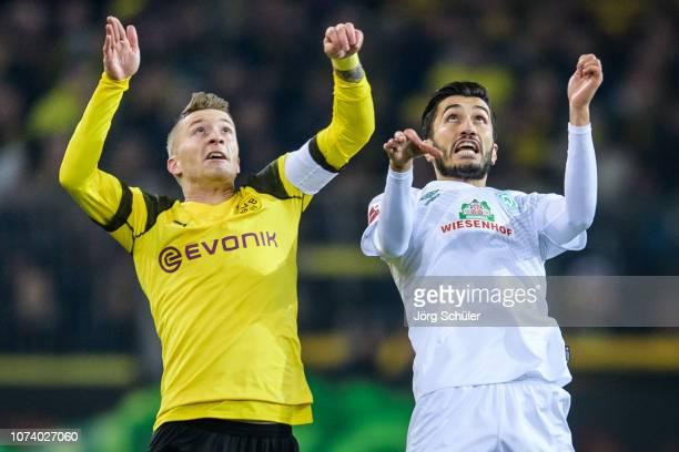 Marco Reus of Dortmund battles for the ball with Nuri Sahin of Bremen during the Bundesliga match between Borussia Dortmund and SV Werder Bremen at...