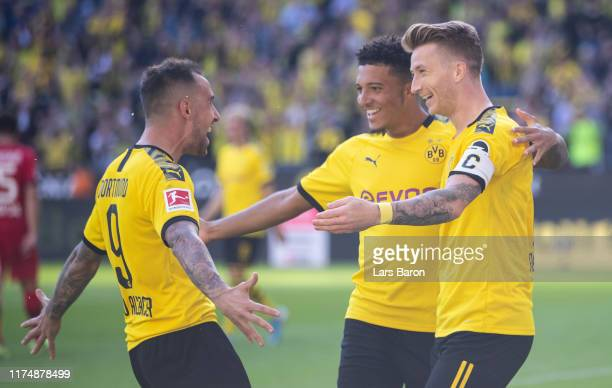 Marco Reus of Dortmund ceelebrates with Jadon Sancho of Dortmund and Paco Alcacer of Dortmund during the Bundesliga match between Borussia Dortmund...