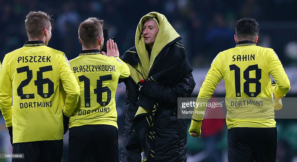 Marco Reus of Dortmund celebrate with his team mates after the Bundesliga match between Werder Bremen and Borussia Dortmund at Weser Stadium on January 19, 2013 in Bremen, Germany.