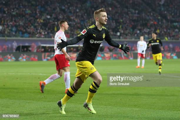 Marco Reus of Dortmund celebrates after he scored a goal to make it 1:1 during the Bundesliga match between RB Leipzig and Borussia Dortmund at Red...