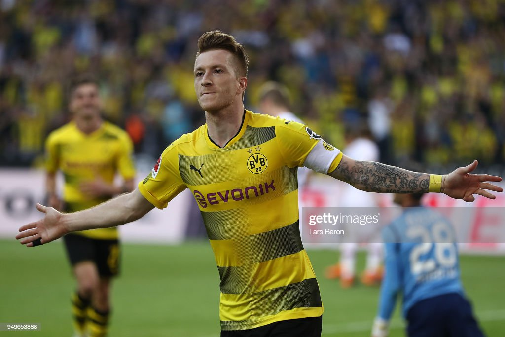 Marco Reus of Dortmund celebrates after he scored a goal to make it 4:0 during the Bundesliga match between Borussia Dortmund and Bayer 04 Leverkusen at Signal Iduna Park on April 21, 2018 in Dortmund, Germany.
