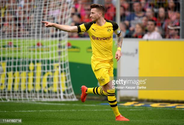 Marco Reus of Dortmund celebrates after he scores the 2nd goal during the Bundesliga match between SportClub Freiburg and Borussia Dortmund at...