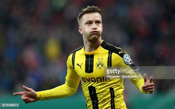 Marco reus pictures and photos getty images marco reus of dortmund celebrates after he scores the opening goal during the dfb cup semi voltagebd Images