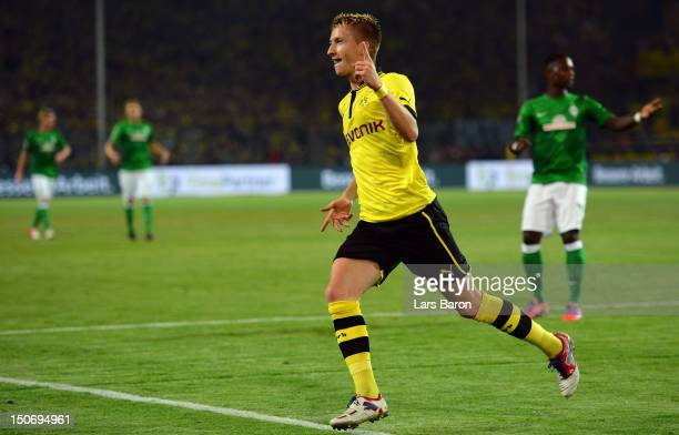 Marco Reus of Dortmund celebrates after scoring his teams first goal during the Bundesliga match between Borussia Dortmund and Werder Bremen at...
