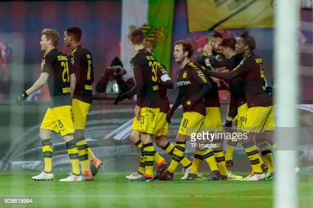 Marco Reus of Dortmund celebrates after scoring his team`s first goal with team mates during the Bundesliga match between RB Leipzig and Borussia...