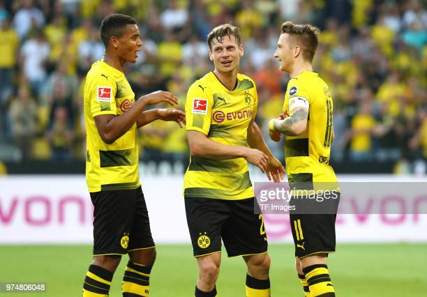 Marco Reus of Dortmund celebrates after scoring his team`s fourth goal with Manuel Akanji of Dortmund and Lukasz Piszczek of Dortmund during the...