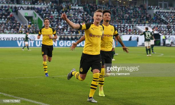 Marco Reus of Dortmund celebrates after scoring his team's opening goal with Jadon Sancho of Dortmund during the Bundesliga match between VfL...
