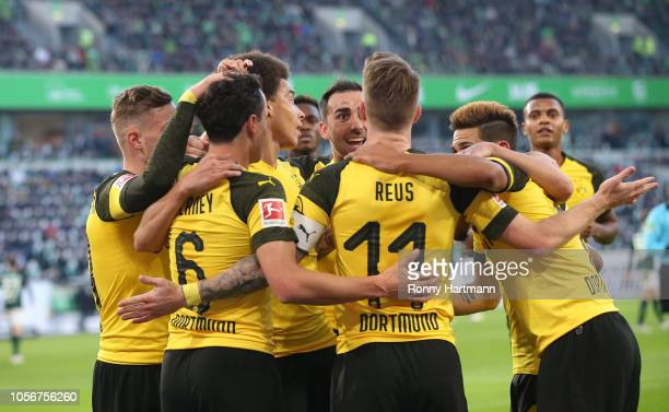 Marco Reus of Dortmund celebrates after scoring his team's opening goal with team mates during the Bundesliga match between VfL Wolfsburg and...