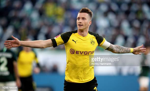 Marco Reus of Dortmund celebrates after scoring his team's opening goal during the Bundesliga match between VfL Wolfsburg and Borussia Dortmund at...