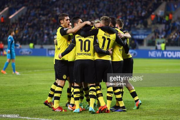 Marco Reus of Dortmund celebrates his team's second goal with team mates during the UEFA Champions League Round of 16 match between FC Zenit and...