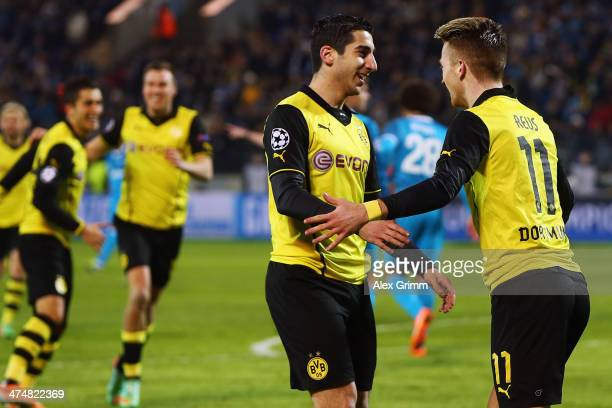 Marco Reus of Dortmund celebrates his team's second goal with team mate Henrikh Mkhitaryan during the UEFA Champions League Round of 16 match between...