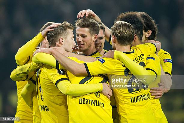 Marco Reus of Dortmund celebrates his team's third goal with his team mates during the UEFA Europa League Round of 16 First Leg match between...