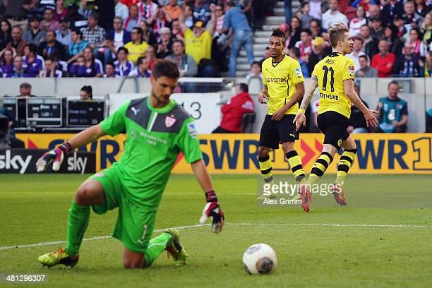 Marco Reus of Dortmund celebrates his team's third goal with team mate PierreEmerick Aubameyang as goalkeeper Sven Ulreich of Stuttgart reacts during...