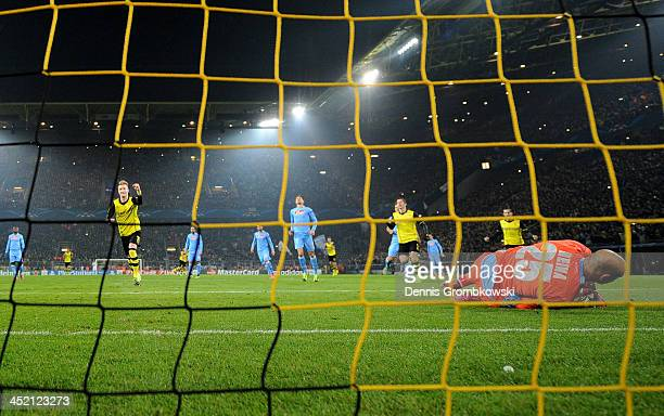 Marco Reus of Dortmund celebrates scoring from the penalty spot past goalkeeper Pepe Reina of Napoli during the UEFA Champions League Group F match...