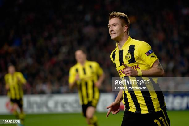 Marco Reus of Dortmund celebrates scoring his team's first goal during the UEFA Champions League Group D match between Ajax Amsterdam and Borussia...