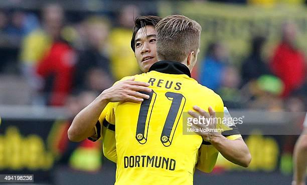 Marco Reus of Dortmund celebrates scoring the 30 goal with Shinji Kagawa of Dortmund during the Bundesliga match between Borussia Dortmund and FC...