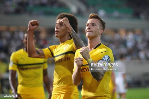Marco Reus of Dortmund celebrates scoring the winning goal with his team mate Axel Witsel during the DFB Cup first round match between SpVgg Greuther...