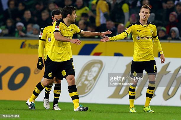 Marco Reus of Dortmund celebrates the first goal with Gonzalo Castro of Dortmund during the Bundesliga match between Borussia Moenchengladbach and...