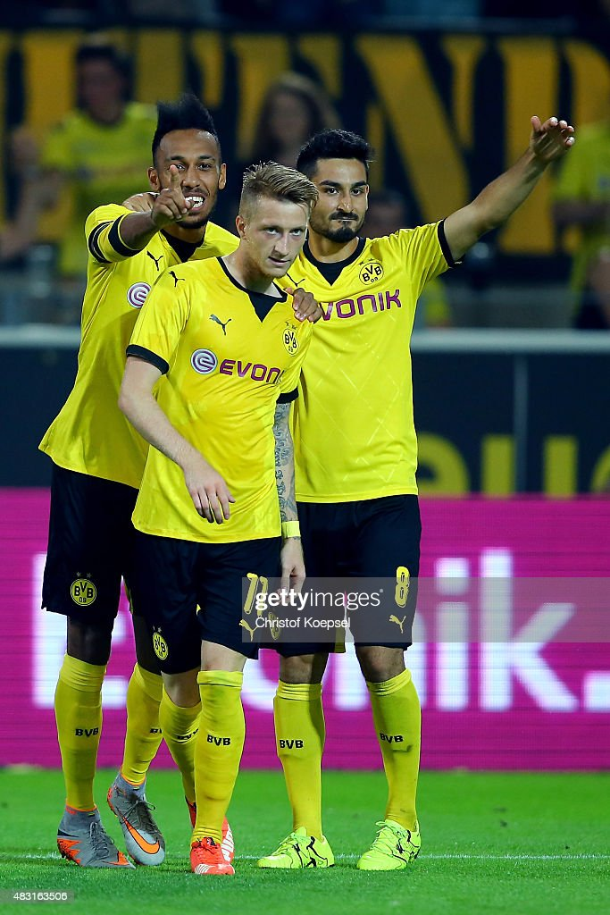 Marco Reus of Dortmund (C) celebrates the first goal with Pierre-Emerick Aubameyang (L) and Ilkay Guendogan of Dortmund (R) during the UEFA Europa League third Qualifying round 2nd leg match between Borussia Dortmund and Wolfsberg at Signal-Iduna-Park on August 6, 2015 in Dortmund, Germany.