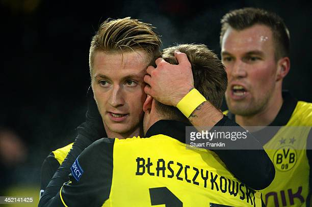 Marco Reus of Dortmund celebrates victory with Jakub Blaszczykowski after the UEFA Champions League Group F match between Borussia Dortmund and SSC...