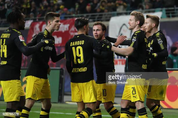 Marco Reus of Dortmund celebrates with his team after he scored a goal to make it 11 during the Bundesliga match between RB Leipzig and Borussia...