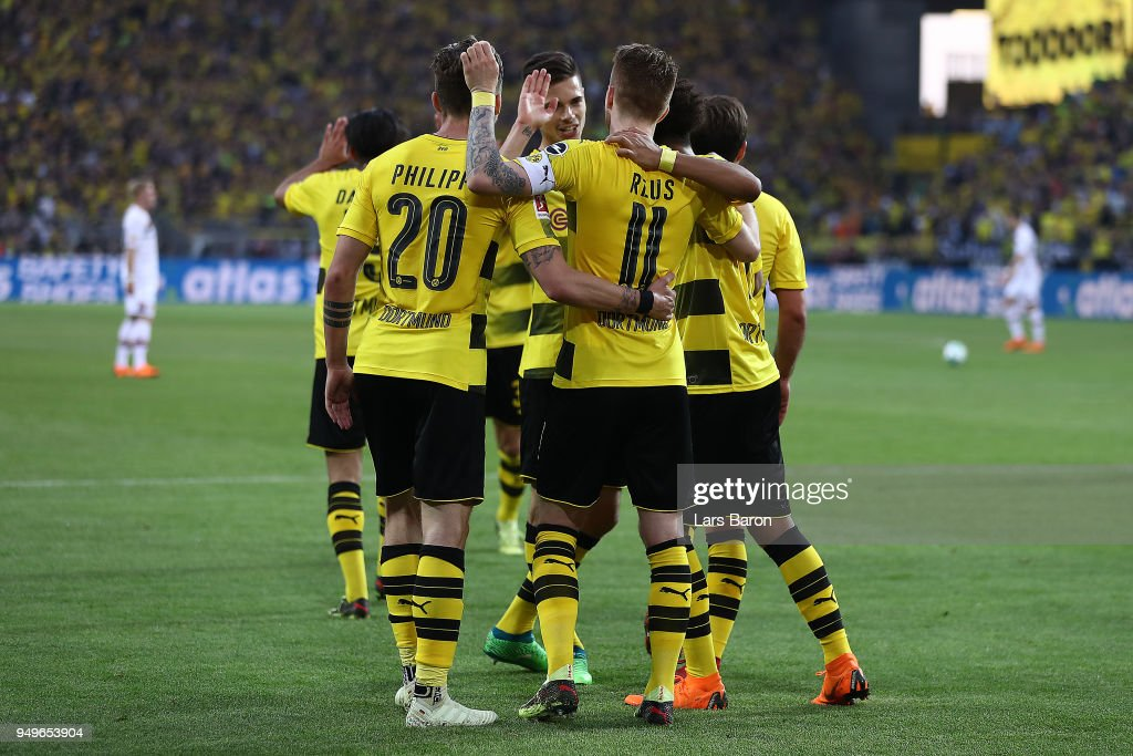 Marco Reus of Dortmund celebrates with his team after he scored a goal to make it 4:0 during the Bundesliga match between Borussia Dortmund and Bayer 04 Leverkusen at Signal Iduna Park on April 21, 2018 in Dortmund, Germany.