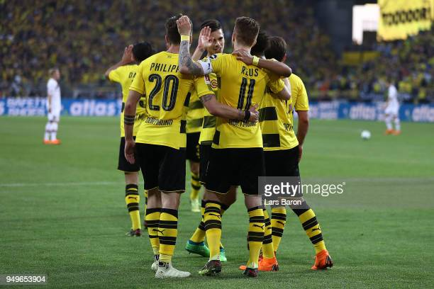 Marco Reus of Dortmund celebrates with his team after he scored a goal to make it 40 during the Bundesliga match between Borussia Dortmund and Bayer...